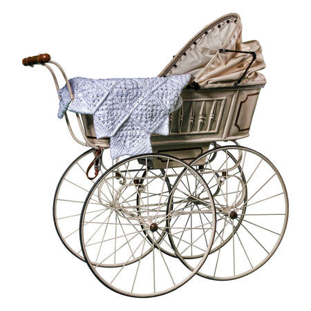 edwardian: isolated edwardian pram in perfect condition, restored and against a while background Stock Photo