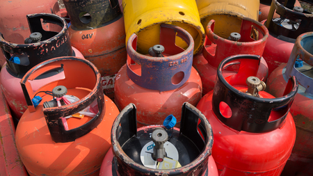 close up image of old empty industrial gas bottles, cannisters staked up 免版税图像
