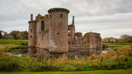 Caerlaverock Castle is a moated triangular castle first built in the 13th century. It is located on the southern coast of Scotland, 11 kilometres south of Dumfries 写真素材