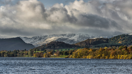 cumbria: A view over Ullswater in the Lake district national park. Snow capped mountains in the distance Stock Photo
