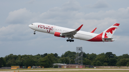 Manchester Airport, UK - August 2, 2015: C-GHPE Air Canada Rouge Boeing 767-33A taking off