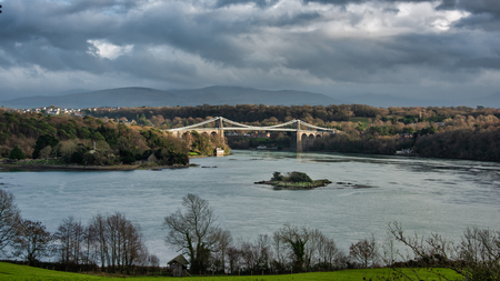A view of the menai straights between Bangor and angles showing the Menai Suspension Bridge.