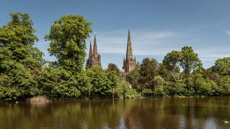 A view of the three spires of Lichfield cathedral in Staffordshire from across Minster pool