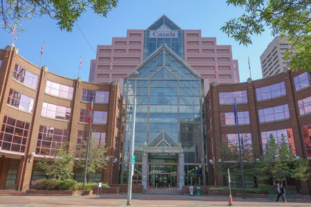 distinctive: EDMONTON, CANADA - AUGUST 8, 2014: Canada Place is a steel and glass office building locally famous for its distinctive pink colour and stepped shape Editorial