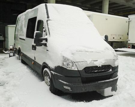 Van under heavy snow in winter Stock Photo