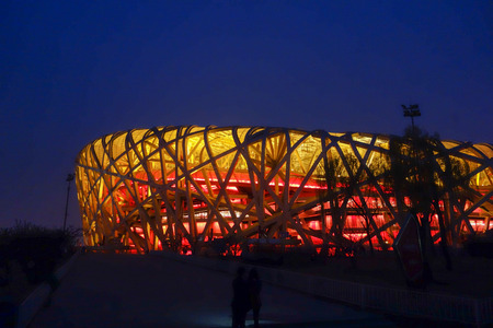 known: BEIJING, CHINA - MARCH 29, 2015: The National Stadium designed by Herzog and De Meuron for the 2008 Olympics Games is known informally as the Bird Nest