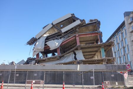 visible: CHRISTCHURCH, NEW ZEALAND - JUNE 11, 2015: Ruins of buildings destroyed in the 2011 earthquake are still visible today in town