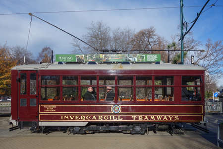 tramcar: CHRISTCHURCH, NEW ZEALAND - JUNE 11, 2015: Tourists on a vintage tram Stock Photo