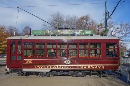 streetcar: CHRISTCHURCH, NEW ZEALAND - JUNE 11, 2015: Tourists on a vintage tram Editorial