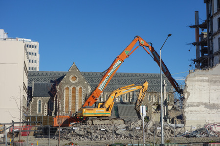 visible: CHRISTCHURCH, NEW ZEALAND - JUNE 10, 2015: Ruins of buildings destroyed in the 2011 earthquake are still visible today in town