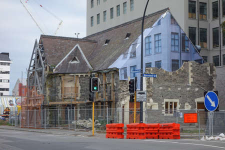 visible: CHRISTCHURCH, NEW ZEALAND - JUNE 13, 2015: Ruins of buildings destroyed in the 2011 earthquake are still visible today in town