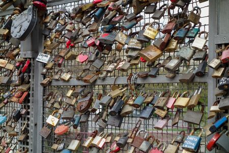 symbolize: BYDGOSZCZ, POLAND - CIRCA APRIL 2016: Love lock padlock sweethearts locked to a fence to symbolize eternal love on a bridge