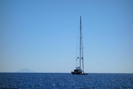 ELBA ISLAND, ITALY - CIRCA AUGUST 2016: View of a boat off Montecristo Stock Photo