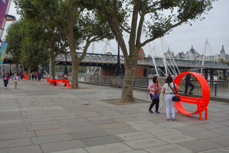 LONDON, UK - CIRCA SEPTEMBER 2016: Tourists on the South Bank of River Thames