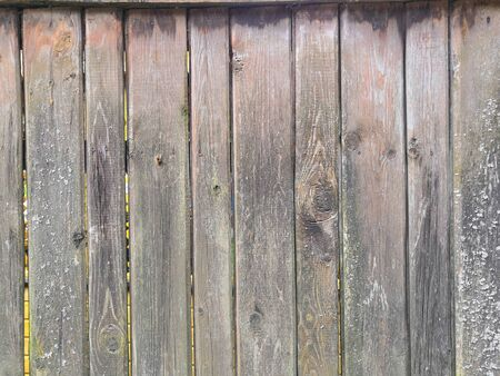 Brown grey wooden background- Painted old wood facade with - Vintage house front with weathered fence Reklamní fotografie