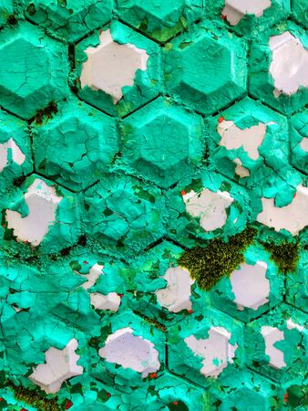 Hexagonal shaped plain old blue turquoise tiles, creating a ceramic pattern. Background