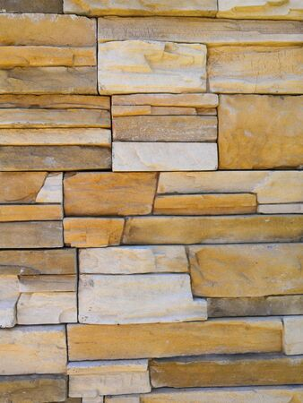 Multicolor of Stone ceramic Brick wall beautiful color texture background for art interiors design in home, house, building, shop, store, art store, coffee shop