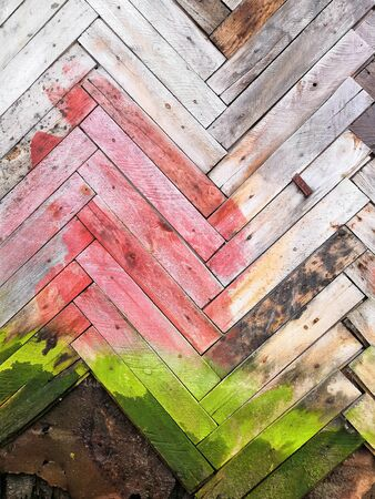Colored old wooden wall and slats with mold. Painted green gray pink Wood Shabby Background. Wooden Barn Wall Texture. Rustic Fence Color Weathered Panel. Abstract Hardwood Exterior Stained Surface. Abstract Aged Wood Banner Billboard Signboard