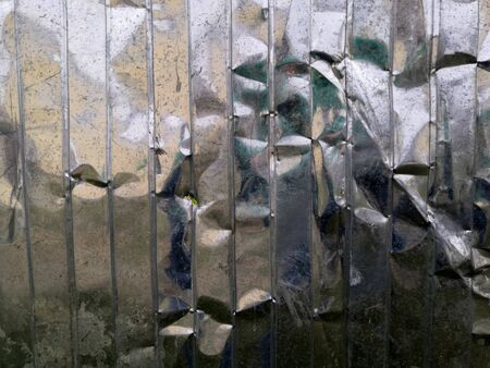 Metal blank surface painted with silver color. Texture of metal broken silver fence