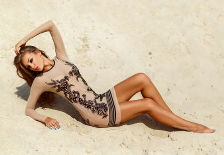 girl on the sands of sunny hot summer photo
