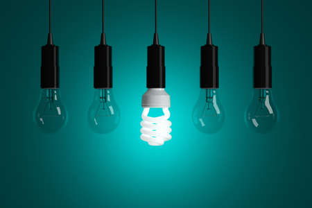 Light bulbs on cyan background photo