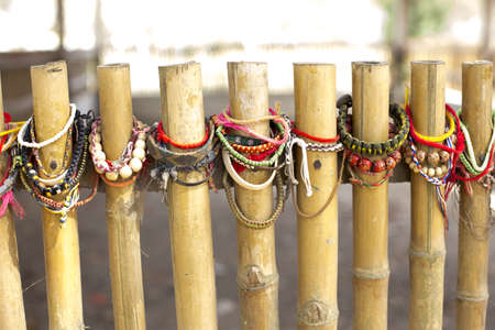 wristbands: Wristbands on a bamboo fence at a mass grave in Cambodia
