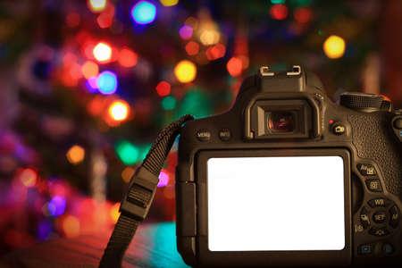 空白の画面とデジタル カメラのクリスマス シーン。