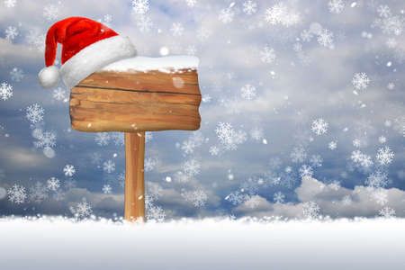 outdoor blank billboard: Snow falling on a blank wooden sign isolated on a snowflake background Stock Photo
