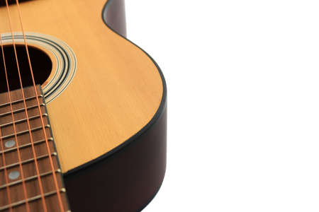 Close up of an acoustic guitar isolated on a white background Standard-Bild - 112617130