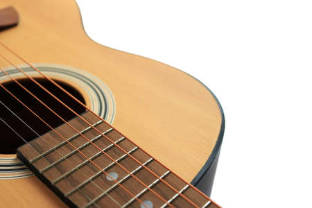 Close up of an acoustic guitar isolated on a white background Standard-Bild - 112617137