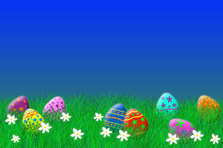 Colorful easter eggs laying in the grass under a blue sky