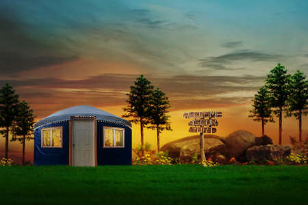 Tranquil scene of a blue yurt in nestled in the remote country
