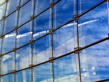 Beyond a reflective curtain wall lies a partly-cloudy day Reklamní fotografie - 20986299