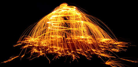 ignited: Ignited steel wool spun around forms a tree and releases sparks