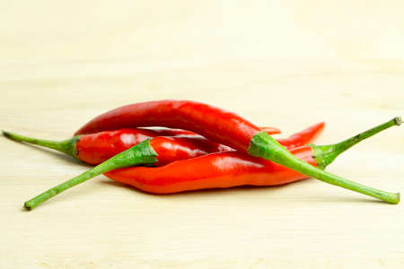 red chilli: red chilli on wooden board