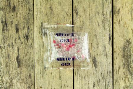 silica: silica gel in plastic bag on wood plank