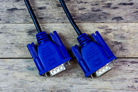 vga: VGA cable on wood background, close-up Foto de archivo