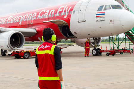 UDON THANI, THAILAND - OCTOBER 6, 2015: Air Asia staff on ground in the airport for security Editorial