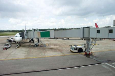 jetliner: jetway to a plane in airport, transport