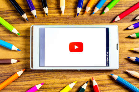 BUNGKAN, THAILAND - NOVEMBER 10, 2015: new youtube logo on smart phone with color pencil around Editorial