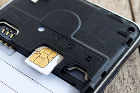 roaming: sim cards on smart phone, soft focused