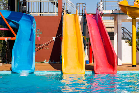 slider: colorful plastic slider in public water park Stock Photo