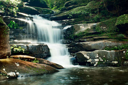 Beautiful waterfall in Thailand, Tad Pho, Ban Paeng, dark tone with vignette Stock Photo