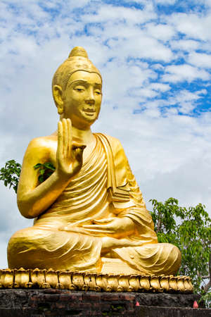 Gold Buddhist on beautiful sky background, soft focus Stock Photo