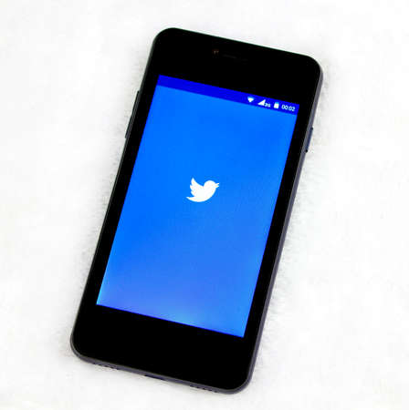 microblogging: BUNG KAN, THAILAND : AUGUST 10, 2016: Smart phone with twitter app on screen