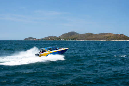 speed boat driving to island, blurred passenger Stock Photo