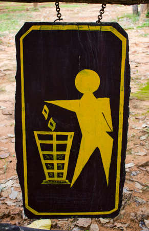 keep clean: man and trash painted on wooden sign Stock Photo