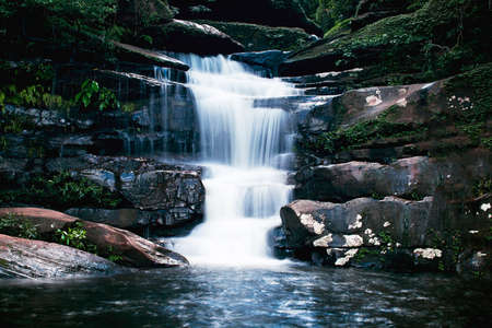 beautiful waterfall with dark toned, vignette corner