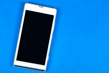smart phone display empty screen on blue background Stock Photo