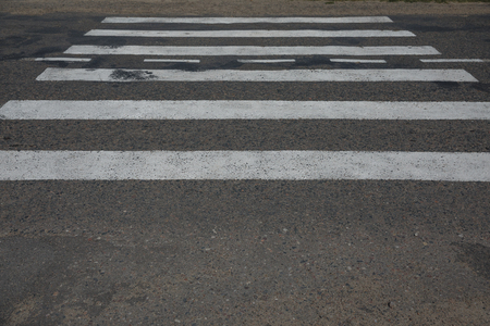 pedestrian crossing without people and cars in the woods close up Stok Fotoğraf